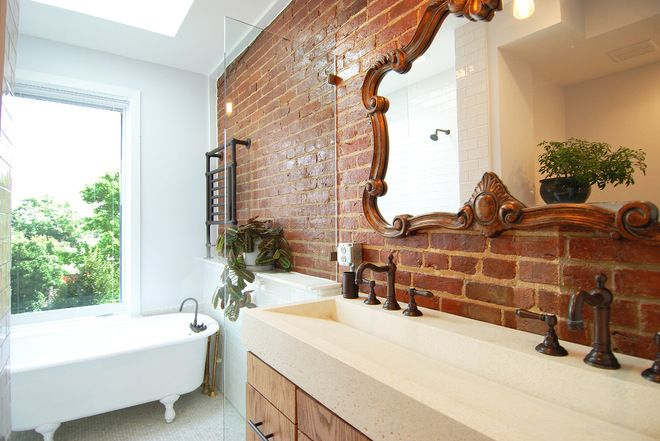 Exposed brick, towel warmer, claw foot tub and antique mirror