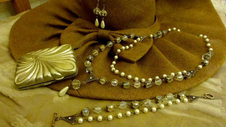 I used crystal beads and glass pearls with antique brass fittings to create nice vintage style jewerly set.