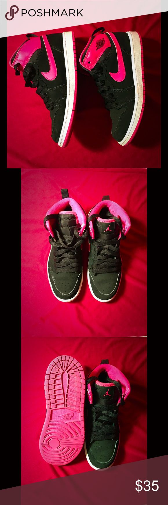 Girls Nike Jordans Girls Nike black, white and pink suede Jordans. These were pre-loved but are in excellent condition.  Worn by a little girl who worn school uniform and tennis sneakers (for tennis) so these hardly got any play time. Size: 1.5M Nike Shoes Sneakers