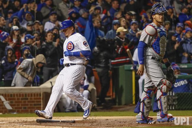 Chicago Cubs left fielder Kyle Schwarber scores on third baseman Kris Bryant RBI double off Los Angeles Dodgers starting pitcher Alex Wood…