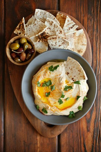 This recipe comes from Zahav, the chef Michael Solomonov's Israeli restaurant in Philadelphia, which is known for its silky and wonderfully rich hummus. Garlic and lemon play small roles here; the indisputable co-stars are the freshly cooked chickpeas and the nutty tahini. (Photo: Craig Lee for The New York Times)