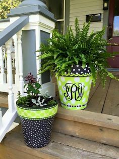 Painted giant planters on porch steps