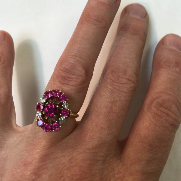 Clearance!!!!::Vintage- 10k 2-toned synthetic ruby A great era piece - 10k with synthetic rubies (8)- 3mm stones - with a center 5mm- the ring shank is yellow - with white gold accents on the top of the ring - Vintage Jewelry Rings