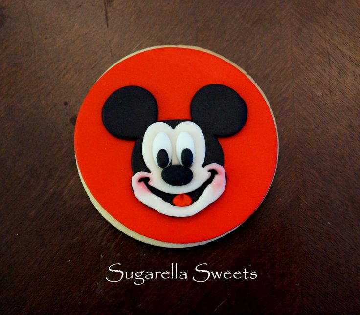 super cute mickey mouse cookie. Perfect to give away as a favor. www.SugarellaSweets.com