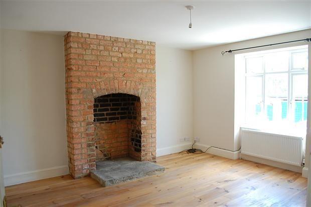 Exposed brick chimney breast Dining Room