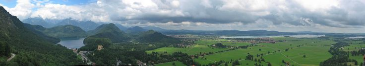 Modern panorama from Neuschwanstein (1,008 m/3,307 ft[7]) showing (left to right): palace access road; Alpsee with locality of Hohenschwangau in front; 19th century Hohenschwangau Castle on a hill with Schwansee behind it on the right (west); locality of Alterschrofen with town of Füssen behind it; core of Schwangau in front of large Forggensee reservoir (1952); Bannwaldsee (north)