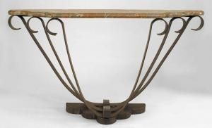 French Art Deco wrought iron console table with brown marble top above scrolling supports (att: RAYMOND SUBES)