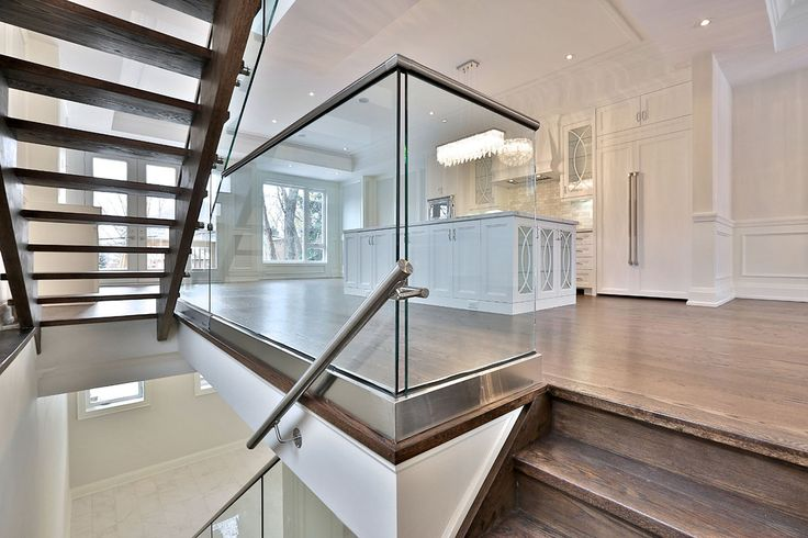 Can we say WOW?! We love the #railing in this spacious #home along with the intricately designed #kitchen island and the #lighting. Entry by Glass Dimensions Inc.  #euroarchitecturalcomponents #euroeac #architecturalcomponents #photocontest #honourablemention #honorablemention #architecture #stainless #stainlesssteel #adjustablestandoffs #standoffs #aluminum #PanelGrip #glassrailing #stairway #staircase #landing #handrails #brackets #interior #interiorrailing #interiordesign #homedecor…