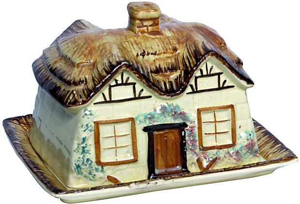 """This charming Cottage Ware covered butter dish has raised decoration. The lid is a thatched roof with a chimney finial. Marked """"KSP,"""" which stands for Kelle St Pottery Co. of England."""