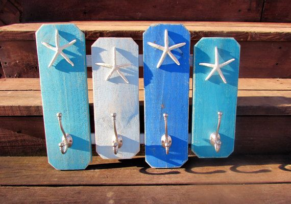 Coastal Towel Rack. Beach Coat Rack. Coat Hooks. Towel Hooks. Starfish Towel Rack. Beach House. Beach Fence Hook Rack  You cannot go wrong with this towel/ coat rack. It just screams BEACH! This is finished in 4 different beachy blues and distressed to give it that sand blown worn look. Each board is sporting a double hook and a REAL finger starfish. These come ready to hand with D RING hangers attached to the back. spaced 16 apart so i can be mounted on a stud for security. Measurements...