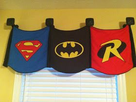 Cute curtains and DIY super hero logo canvases. @Nicole Platt this would look great in Ethan's room!