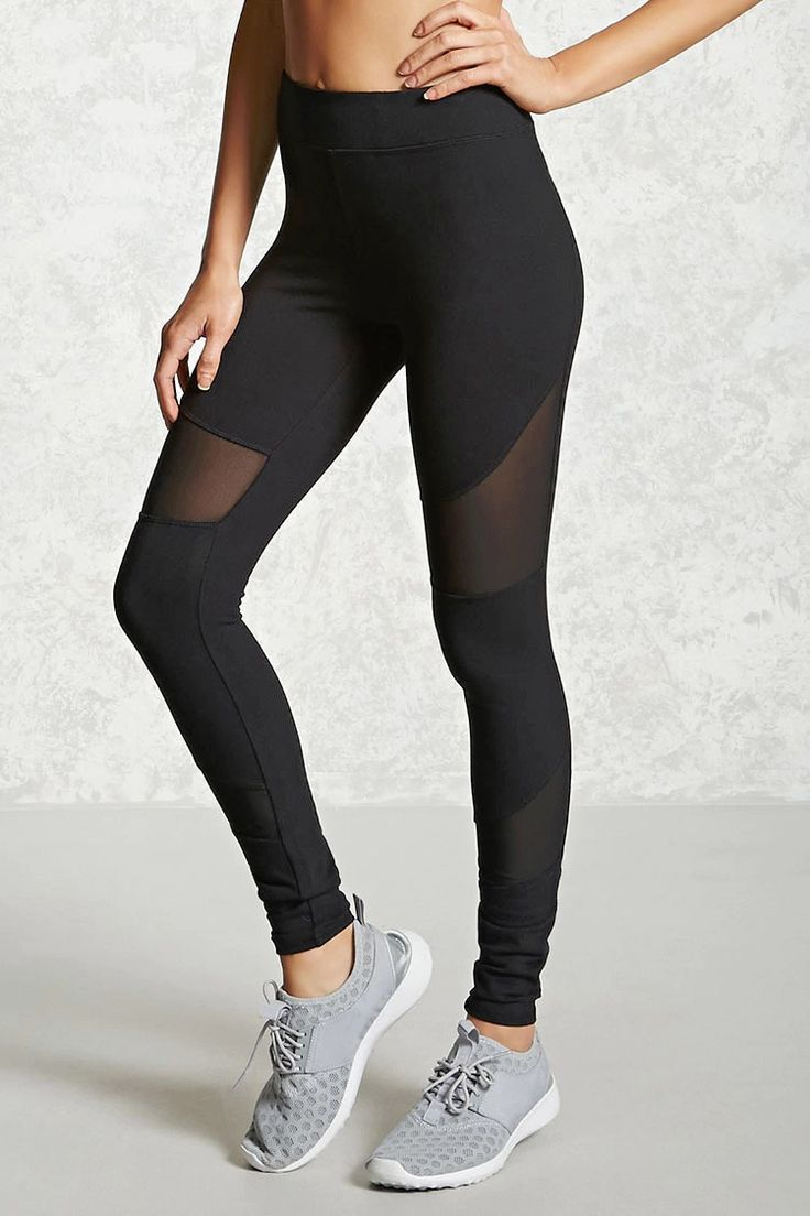 A pair of knit athletic leggings featuring sheer mesh panels, a hidden key pocket, and an elasticized waist.