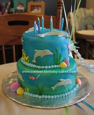 Homemade Dolphin Birthday Cake: For this Dolphin Birthday Cake I made two tiers - one with a Wilton 6 inch pan and one with a Wilton 8 inch pan.  It is covered with blue marshmallow fondant