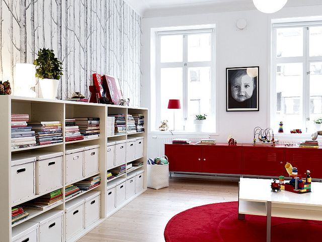 A little too much closed storage on the left but I love the idea of some ability to hide things with the red pieces (IKEA?) plus I like the pop of red and how it doubles as a work table.