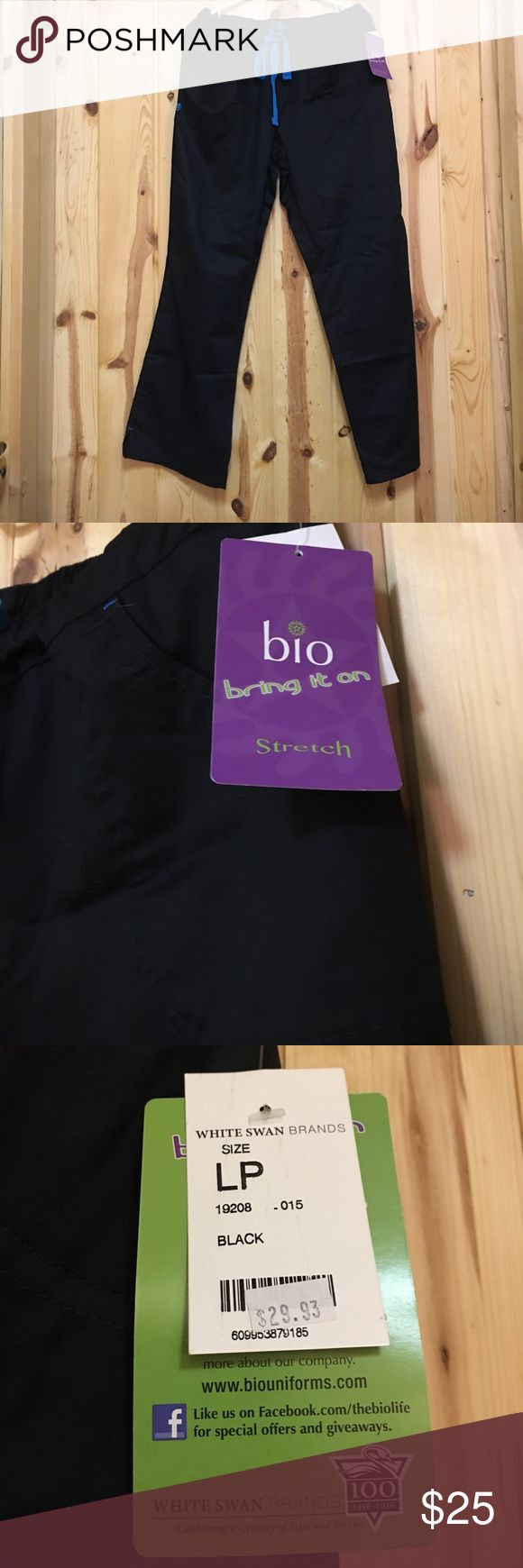 Bio Scrub Pant Large Petite Black /blue ties NWT Bio Scrub Pant Large Petite Black /blue ties NWT  Pant is 55% Cotton 42% Polyester and 3% Spandex  Pant has 2 Side Pockets and one Back Pocket  Elastic Waist in back Very Comfy and Stylish Bio Scrubs Pants