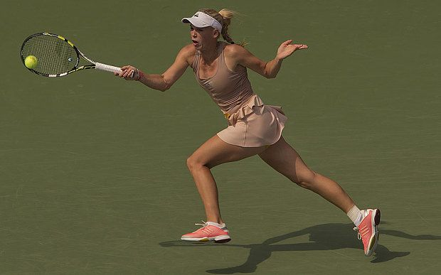Marathon training helps a rejuvenated Caroline Wozniacki to beat fifth seed Maria Sharapova 6-4, 2-6, 6-2 in the fourth round of the US Open.