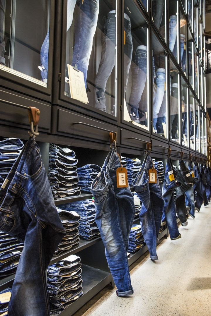 Jack Jones store by Riis Retail Bremen Germany --- This good idea can cut down on people taking out pants from piles.Feeling the fabric and checking them out without making a mess!