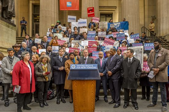 On February 08, 2017; at the steps of Federal Hall Monument in New York City, backed by the state's leading good government groups and elected officials, Attorney General Eric T. Schneiderman today introduced the New York Votes Act, a comprehensive reform package aimed at simplifying the voting process, boosting voter registration, and increasing voter turnout. The Attorney General's Office is committed to the voting rights protecting all eligible New Yorkers.