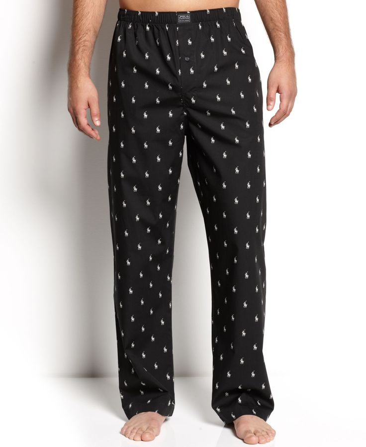 This soft cotton pant is a simple luxury that you should not be without. Relaxed fit with elastic waistband and single button fly. Polo player print all over. Logo applique at front waistband.   Cotto