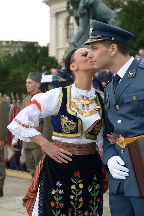 Girl in Serbian national costume with Serbian soldier at Military Parade 2014. celebrating 70 years of Belgrade liberation in WW II