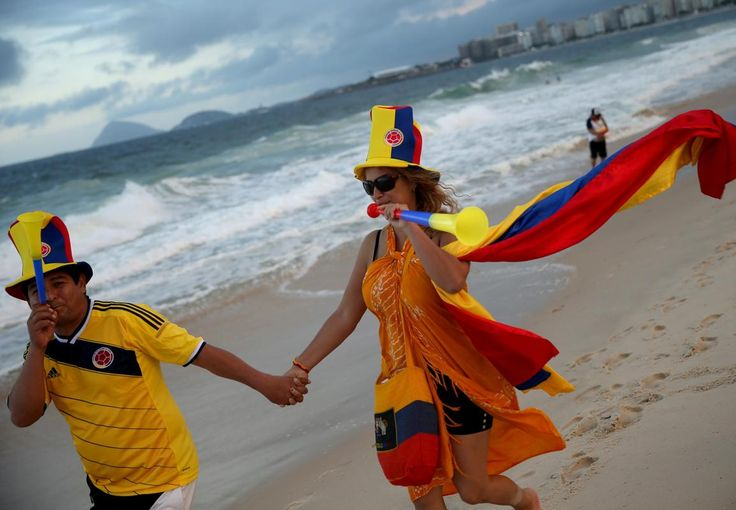 Colombia - Colombian soccer team fans, Pedro Caicedo Ramirez (L) and Isabel Maldonado, from Colombia, enjoy Copacabana beach while waiting for the start of the 2014 FIFA World Cup on June 11, 2014 in Rio de Janeiro, Brazil. Brazil continues to prepare to host the World Cup which starts on June 12th and runs through July 13th. (Joe Raedle/Getty Images)