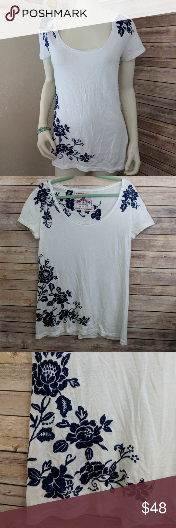 Johnny Was scoop neck dark blue embroidered tee Shirt features dark blue embroidered flowers decorating the sleeves, back of neck, and the bottom of one side against a white cotton tee.  Shirt is somewhat long design. Gently worn with no real sign of wear. Johnny Was Tops Tees - Short Sleeve