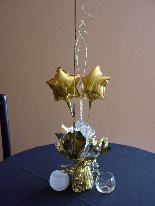 Gold stars balloon centerpiece hollywood theme