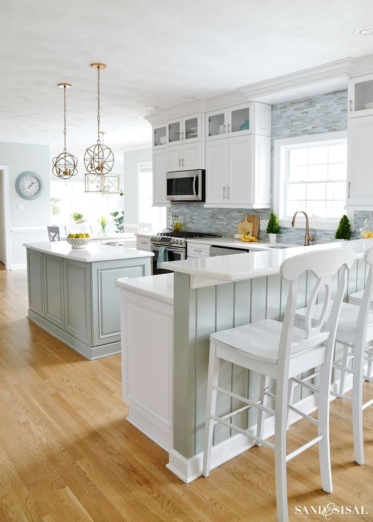 every end panel has special treatment.  cabinets to the ceiling.  backsplash tile to the ceiling.  bright white, open, and airy