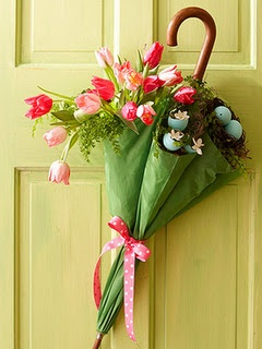 An Easter/Spring door decoration made from a ribbon-tied parasol, colorful tulips and blue robins' eggs...