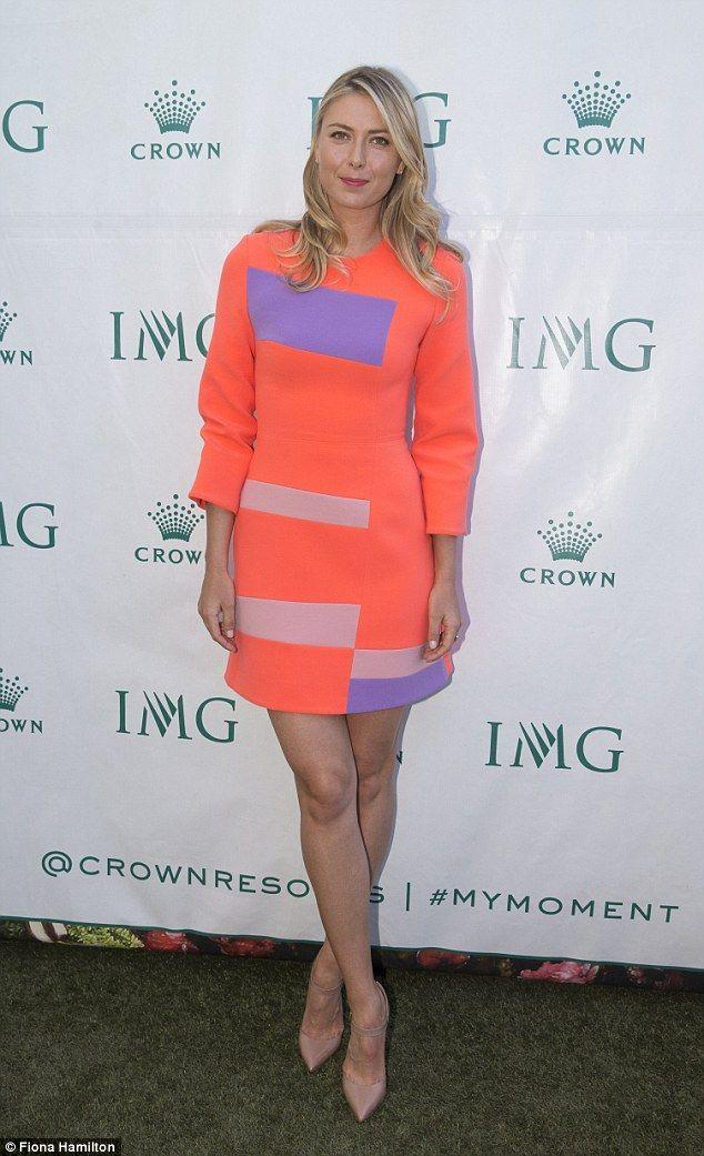 Maria Sharapova Showcases Her Legs In Orange Mini Dress -3357