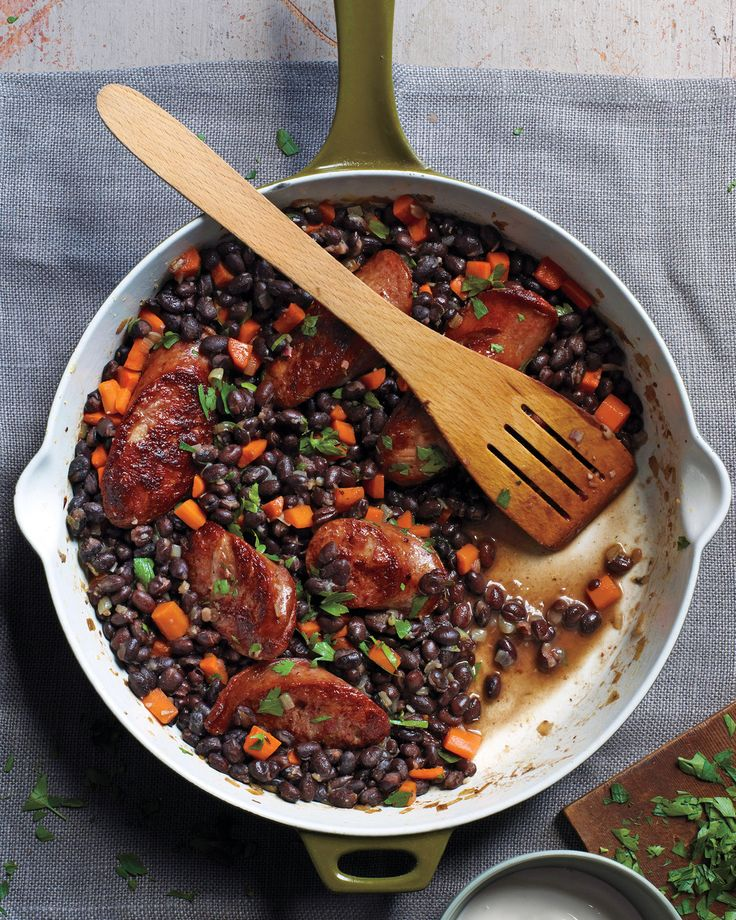 Black Beans and Sausage | Martha Stewart Living - Make this quick weeknight meal in 40 minutes using canned black beans and smoked sausage, such as Polish kielbasa.