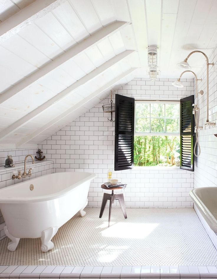 Love the subway tiles with dark grout, black shutters, clawfoot bathtub and shiplap walls.