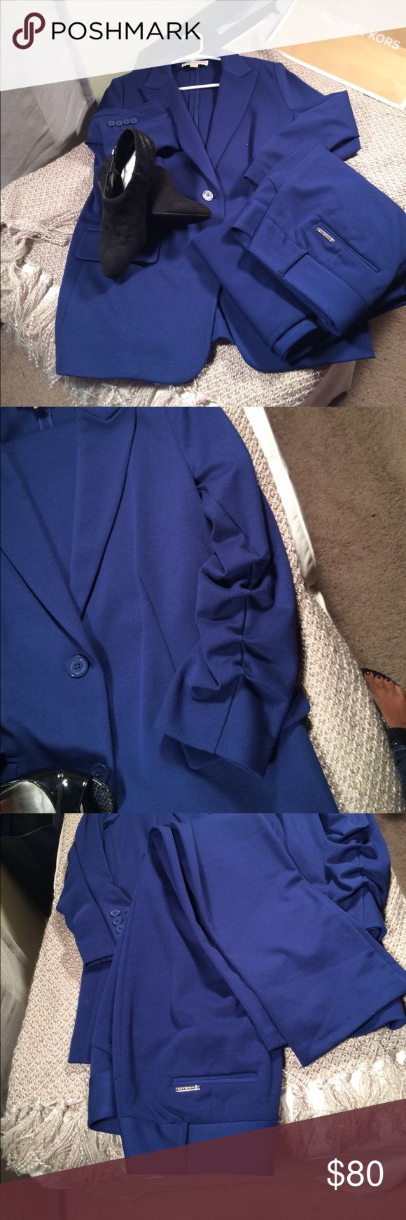 Michael Kors suit/ Brand new condition This beautiful suit has only been worn twice brand new condition original and authentic Michael Kors suit. Beautiful blue color. It's in between a royal blue and navy. Has stretch in the jacket and the pants. Straight leg trouser pants inseam measurement is 30 inches. Pants are a size 14 and jacket a large. Don't pass this one up ladies! This one is in great condition and pennies on the dollar! Michael Kors Pants Straight Leg