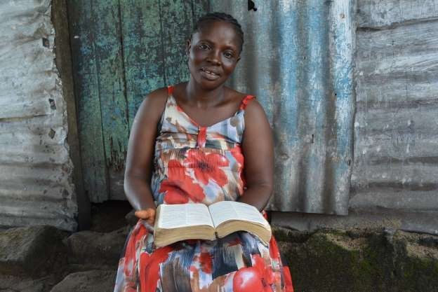 Dorothy Sawer is a Liberian prayer warrior, pictured here in Sept. 2014, and her most treasured possess is her dog-eared Bible. The faith healer was called to help victims of Ebola and it wasnt long before she got sick too. (Robyn Dixon/Los Angeles Times/MCT)