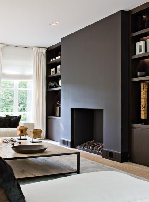 Living room - matte black walls. Ideally I would include a built in stove here rather than an open fire.