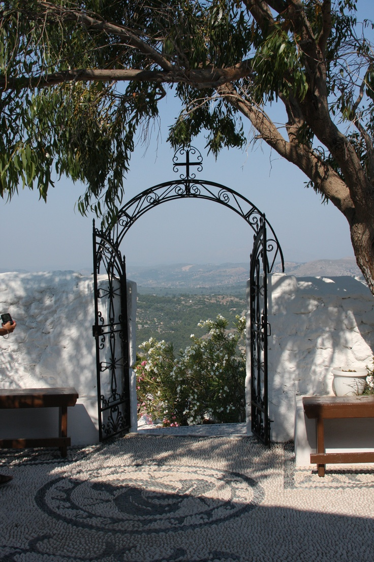 Beautiful gate at the top of the mountain leading into the Monastery of Tsambika, Rhodes, Greece.