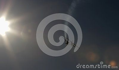 Airplanes on air show sun rays Airplane performing difficult maneuver in the sky. Blue clear sky. Blue background.