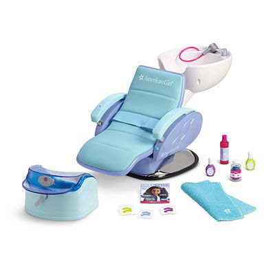 "Spa Chair Item# F5355 Just like the real thing, this padded spa chair tips back so she can ""wash"" her doll's hair with the pull-out sprayer, or give her a pedicure in the foot bath. The faucet and footbath make bubbly water sounds! Set also includes: A faux bottle of shampoo A bottle of pretend spa salts Make-believe nail polish bottles An embroidered bath towel Three sheets of nail stickers A mini magazine for her doll to read while she enjoys salon treatments $110"