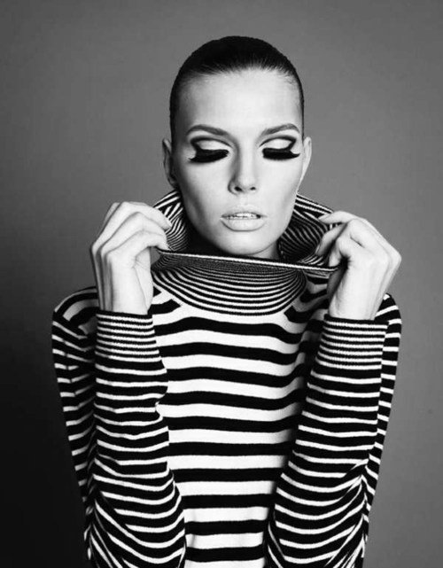 Bold 1960s fashion stripes black and white striped sweater