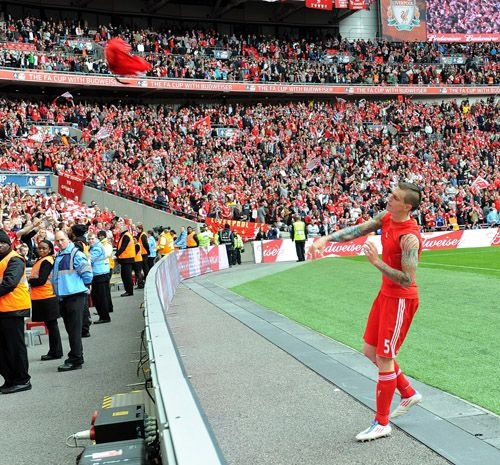Daniel Agger throws his shirt into the crowd at Wembley