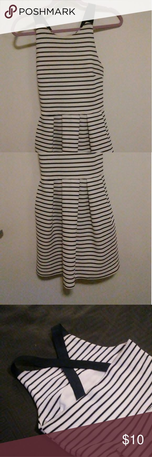 Almost Famous Stripe Criss Cross Back Dress Good condition Almost Famous white/Navy striped dress with cross backs straps.   Size Medium 95% polyester  5% Spandex   Length: 30 inches Chest: 15 inches  Waist: 14 inches Hem: 33 inches  Small hole under right arm (photo) Preowned  No visible stains. Almost Famous Dresses