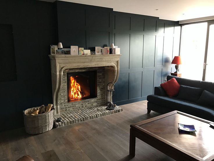 The Stuv Micro Mega in an antique fireplace at Hobbyfields. This beautiful home was built by Gynn Construction Stûv #fireplaces #cornwall