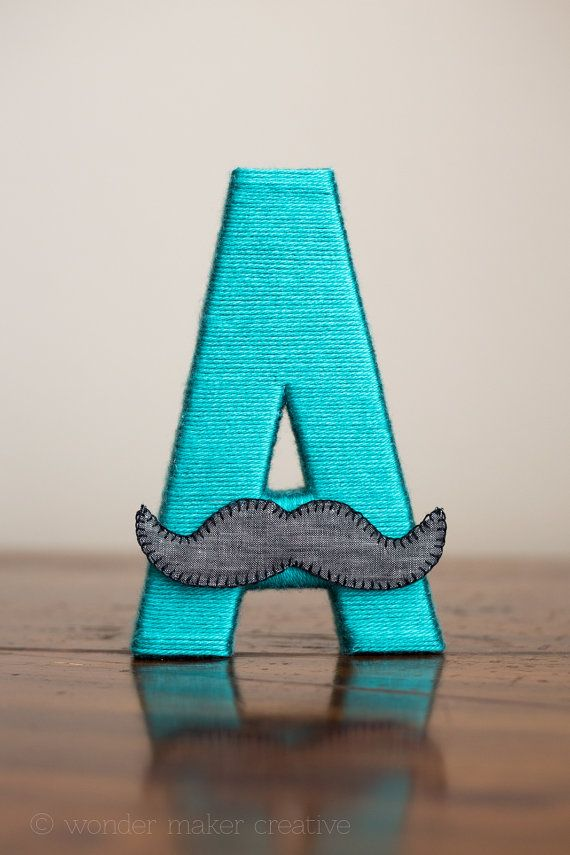 With the little mustache! I tried wrapping letters myself and they are sooo hard! $25