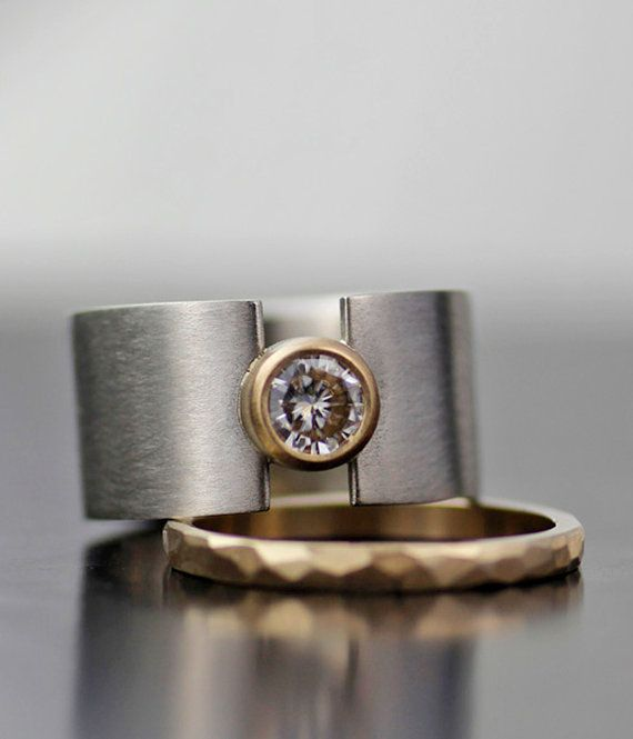 An upscale take on my popular lunar eclipse sterling silver band, this time I used pure 950 palladium, took down the width just a smidge, and added a 5.5mm sparkly moissanite. Minimalist, modern, timeless design with just a little edge. The stunning sparkle of this large moissanite stone is set alight with a 14K gold setting. The rich color of the 950 palladium brush finished band accents the richness of the gold which is emphasized further by the optional 2mm 14K gold band (optional)  The…