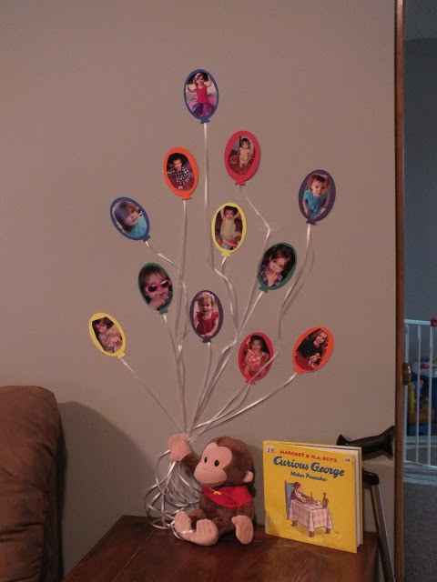 Curious George balloon decorations [centerpiece decoration with first 12 months and 1 year pictures]