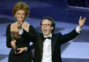 "Roberto Benigni, receiving the OSCAR for BEST FOIREGN FILM from Sophia Loren  ""LA VITA E BELLA"" ( LIFE IS BEAUTIFUL )"