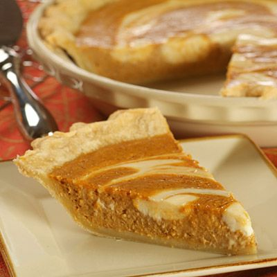 Pumpkin Cheese-Swirled Pie | Meals.com -  Cream cheese adds a delightfully creamy flavor and eye appeal to this Pumpkin Cheese-Swirled Pie for some oooh factor! #fallbaking #thanksgiving #pumpkin