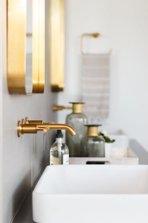 Brushed gold wall faucets