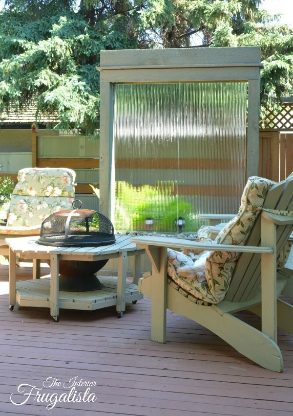 DIY Water Wall perfect for a deck or patio and backlit with solar spotlights | The Interior Frugalista