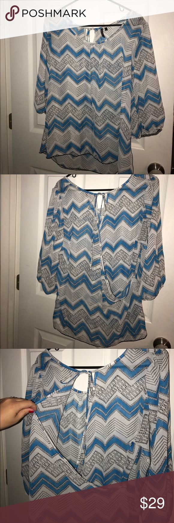 NWOT cute blue chevron top w/ back opening XL NWOT cute blue chevron top blouse with back opening. Size XL. Women's Ladies Fashion. Check out my closet, we have a variety of women's, Victoria Secret, handbags 👜 purse 👛 Aerosoles, shoes 👠fashion jewelry, necklace, clothing, dress, Beauty, home 🏡 .  Ships via USPS. Smoke & Pet-Free. Offers 30% OFF bundle discount. Always a FREE GIFT 🎁 with every purchase!!! Thank you. Tops Blouses